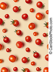 Freshly picked red ripe organic cherry tomatoes on a beige background. Top view. Vegetable vegan pattern.