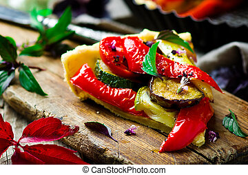 vegetable pie ratatouille on a wooden board. Style rustic....