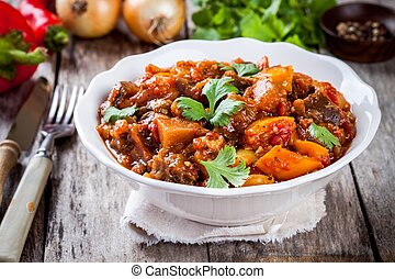 vegetable ragout (ratatouille) paprika, eggplant and tomato on wooden table