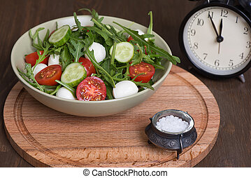 lunch time - vegetable salad in a bowl. lunch time