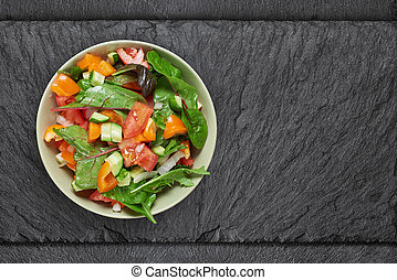 vegetable salad in a bowl on stine table. Top view