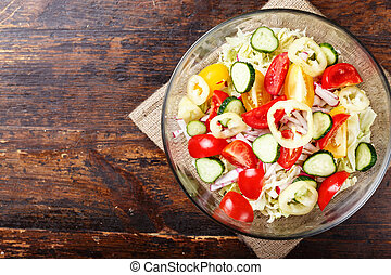 vegetable salad in a plate. top view