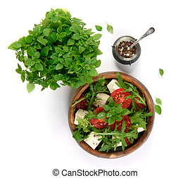 vegetable salad in a wooden bowl on white background
