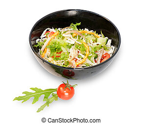 Vegetable salad in black bowl isolated