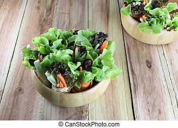vegetable salad in wooden bowl.