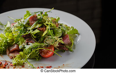 Vegetable salad on a plate on a glass background