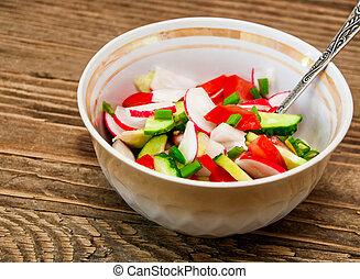vegetable salad on a wooden background