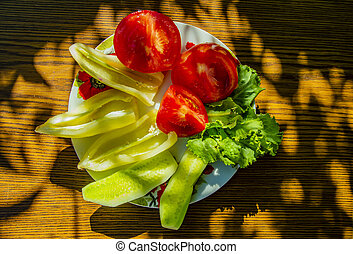 Vegetable salad on a wooden table.