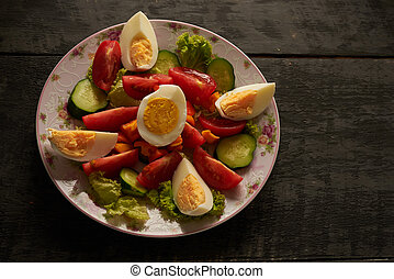 vegetable salad with boiled eggs in a restaurant