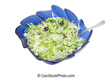 Vegetable salad with Chinese cabbage, olives, meat in salad bowl