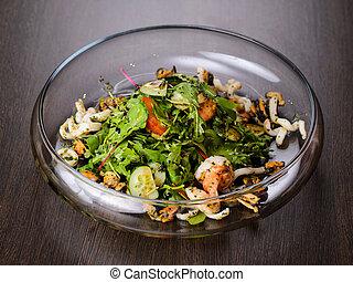 Vegetable salad with seafood on plate