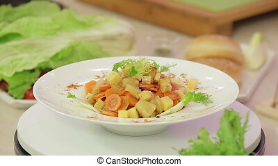 Vegetable salad with stewed pineapple presentation on a...