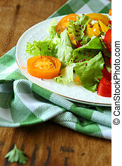 vegetable salad with tomato on plate