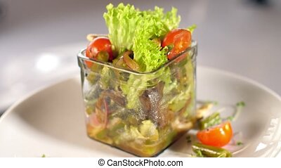 Vegetable salad with tomatoes - Fresh green salad on a plate