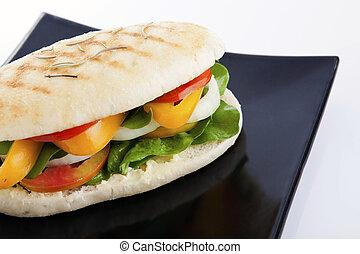 Vegetable sandwich on black plate