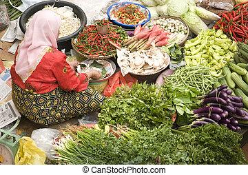 Vegetable Seller at Wet Market - Vegetable seller at a wet...
