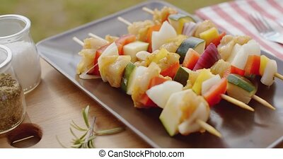Vegetable shish kebap on plate close up - Close up of...