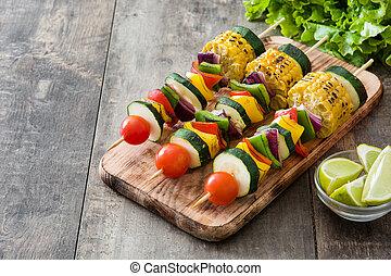 Vegetable skewers on wooden table