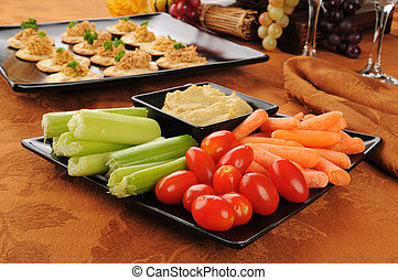 Vegetable snack plate - A plate of vegetables with Greek...