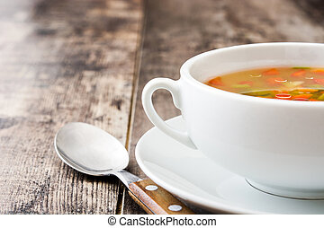 Vegetable soup in bowl on wooden table