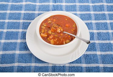 Vegetable Soup in White Bowl with Spoon