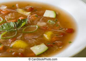 vegetable soup in white plate close up