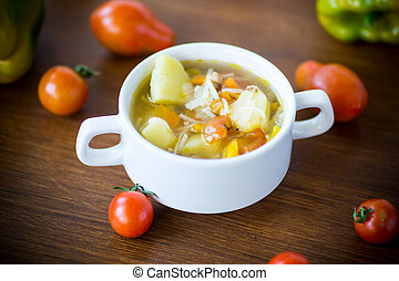 vegetable soup with noodles, tomatoes, peppers and other vegetables in a plate