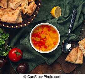 Vegetable soup with tomato and lemon