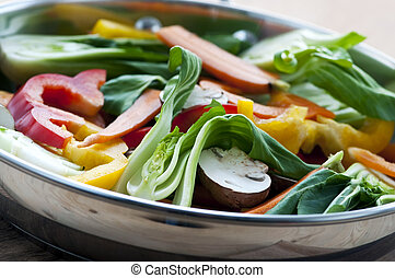 Vegetable stir fry of bok choy mushroom peppers carrots
