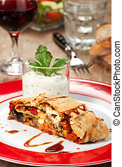 vegetable strudel on a plate with salad