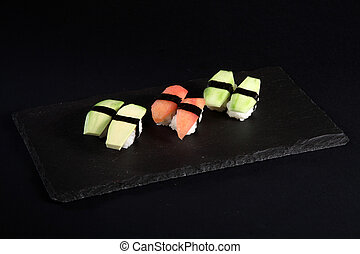 Vegetable sushi on flat slate