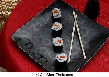 Vegetable sushi rolls - Four sushi rolls placed diagonally ...