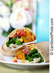 Wrap sandwich with salad and roasted vegetables. A delicious lunch!