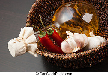 vegetables and a basket with a bottle of vinegar