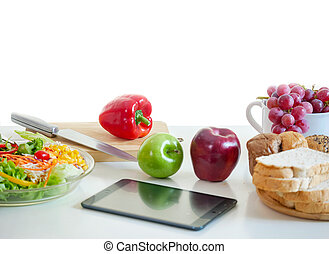 Vegetables and fruit on chopping board with tablet ,modern cooking