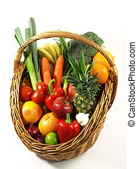 Vegetables and fruits in a basket. isolated - Basket with ...
