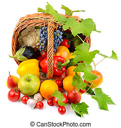 vegetables and fruits in a basket isolated on white background