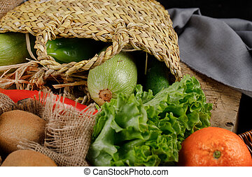 Vegetables and fruits in a rustic basket.