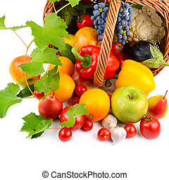 vegetables and fruits in basket isolated on white background