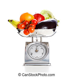 Vegetables and fruits on a weighing scale - Fruits and ...