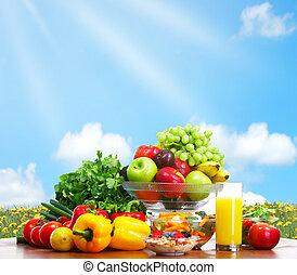 Vegetables and fruits under blue sky