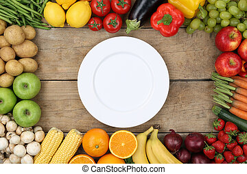 Vegetables and fruits with empty plate