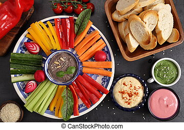 Vegetables and humus. - Colorful fresh vegetables cut into...