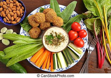 Vegetables and humus. - Colorful vegetables, lettuce,...