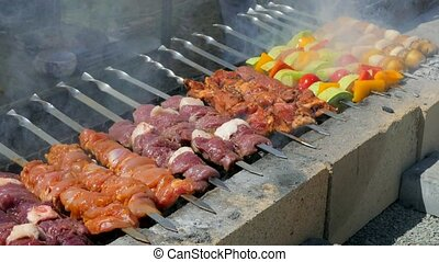 Vegetables and meat are roasted on the grill