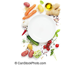 Vegetables around empty white plate