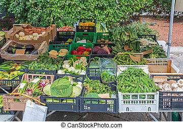 Market Stall - Vegetables at Farmers Market Stall in Trieste...