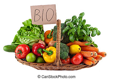colorful vegetable arrangement in the Basket isolated on white