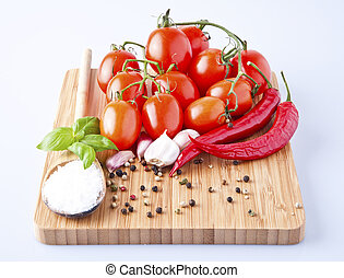 vegetables fresh tomato with onion, garlic and spices on cutting board