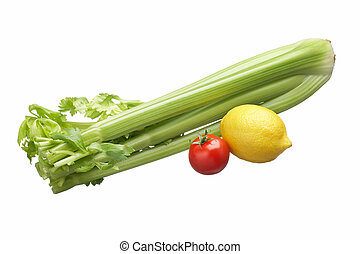 vegetables - green celery, yellow lemon and red tomato